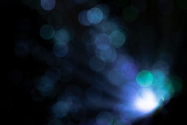 Pontos de luz brilhantes com cores frias