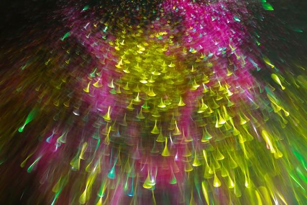 Pontos de luz desfocados abstraem base luzes multicoloridas de incandescência abstratas