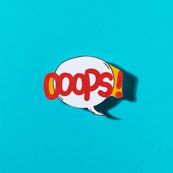 Pop art e design em quadrinhos oops bolha do discurso em pano de fundo azul
