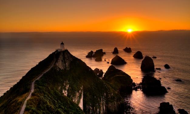 Pôr do sol, em, pepita, ponto, nova zelândia ilha sul