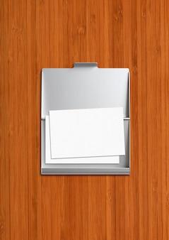 Porta-cartões metálico fechado isolado em madeira escura