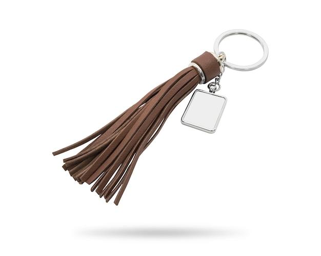 Porta-chaves da borla isolada no fundo branco. corrente chave de couro da forma para a decoração.