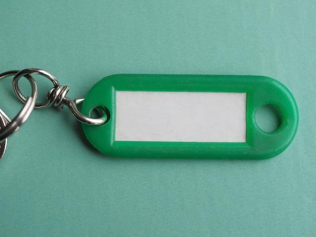 Porta-chaves verde com etiqueta branca