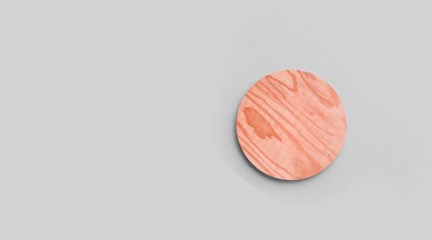 Porta-copos de cortiça redonda vazia, isolada em fundo cinza. perfeito como display de comida.