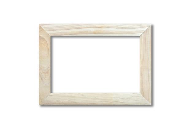 Porta-retrato de madeira pendurada em uma parede branca. modelo de maquete em branco