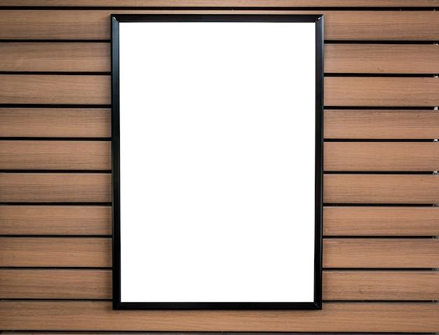 Porta-retratos em branco na parede de madeira