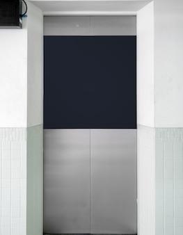Portão de elevador inox com banner