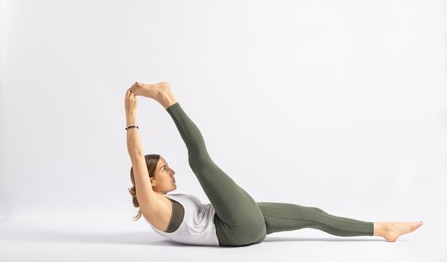 Pose reclinado dedão do pé com alças de postura de ioga asana