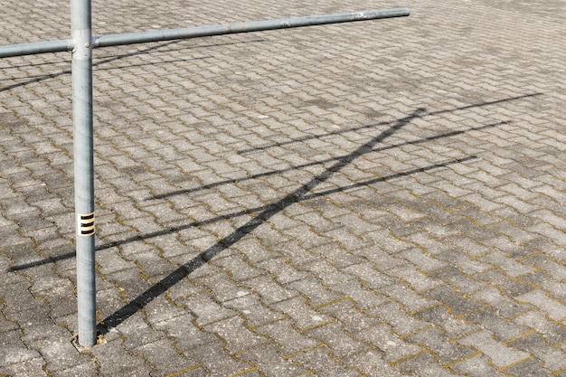 Poste de luz com sombra