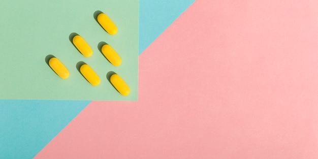 Postura plana de comprimidos com espaço de cópia