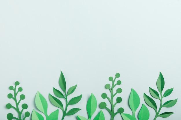 Postura plana de folhas de primavera de papel
