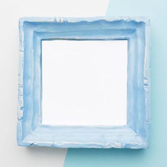 Postura plana do conceito de moldura azul