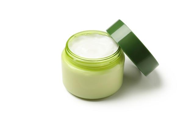 Pote de creme cosmético isolado no branco