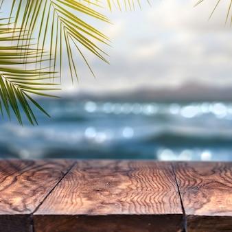 Praia com folha de coco de palma e tampo de mesa de madeira velha na praia turva e vista para promover o conceito de produto. conceito de verão relaxar e festa.