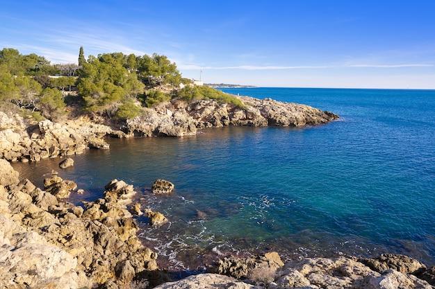 Praia de l'amella de mar em costa dorada