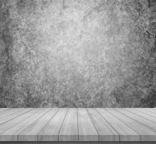 Prancha de madeira velha com fundo de pedra abstrato cinza ou preto para exposição do produto