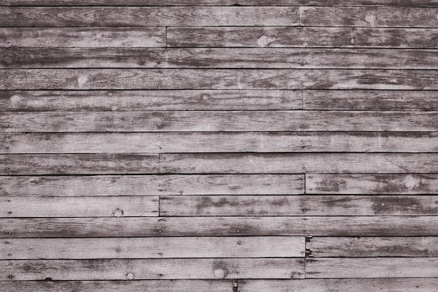 Pranchas de madeira gasto cinza velhas com pintura de cor rachada