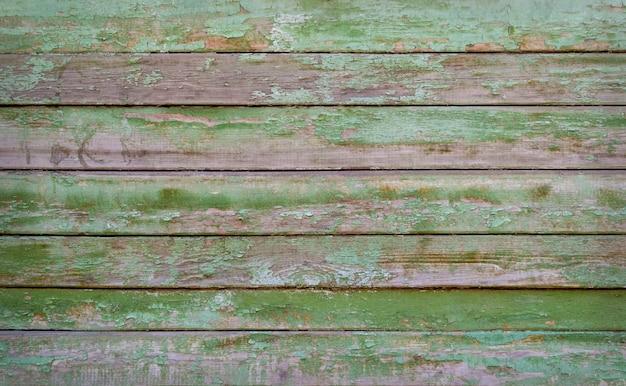 Pranchas de madeira pintadas de verde ou textura.