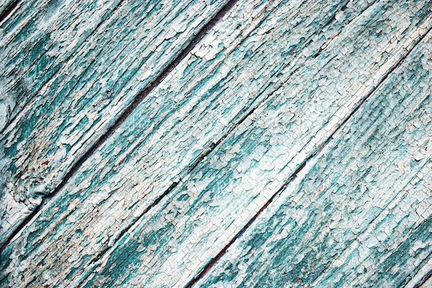 Pranchas de madeira velhas com pintura descascada. plano de fundo para o design. placa velha. efeito do clima na madeira.
