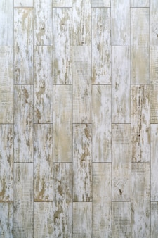 Pranchas de madeira vintage pintadas com tinta branca em camadas. desenho abstrato.