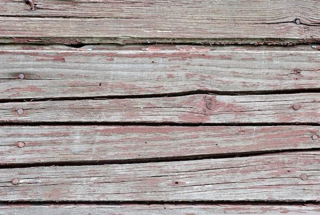 Pranchas vintage vermelhas. organizado horizontalmente. textura. fundo