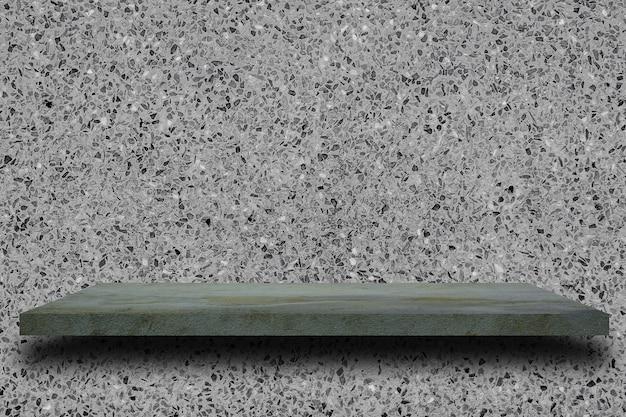 Prateleira concreta vazia na textura cinzenta velha do muro de cimento.