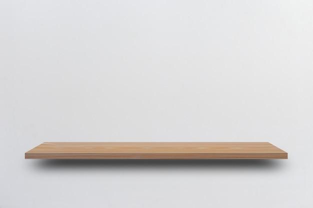 Prateleira de madeira vazia vista frontal e parede cinza