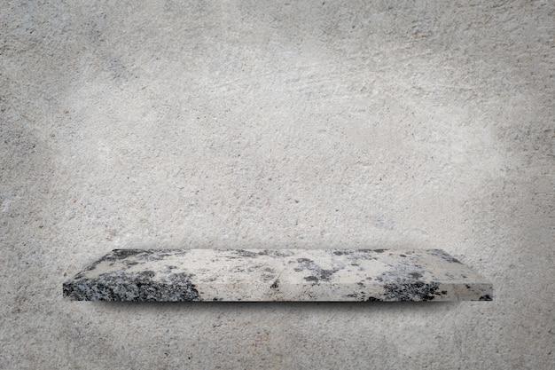Prateleira vazia sobre fundo cinza muro de concreto