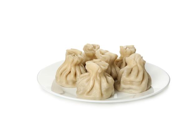 Prato com saboroso khinkali isolado na mesa branca