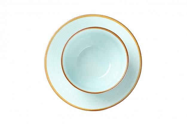 Prato limpo azul e tigela isolado no branco