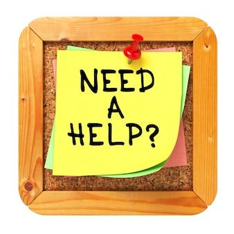 Precisa de ajuda? adesivo amarelo no boletim ou quadro de mensagens da cortiça