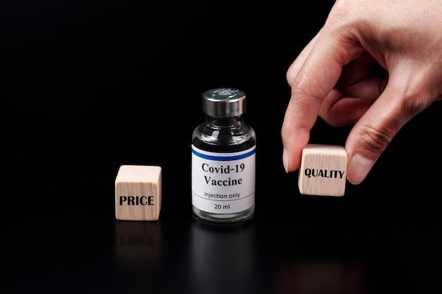 Preço versus qualidade o cubo com a palavra qualidade é selecionado à mão. seleção de vacina