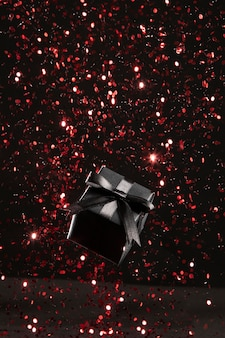 Presente preto com sortimento de glitter vermelho