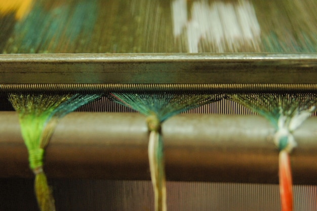 Produção e tecelagem de tapetes e tecidos