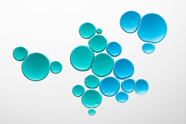 Produto cosmético macro de bolha de óleo líquido de fundo abstrato azul