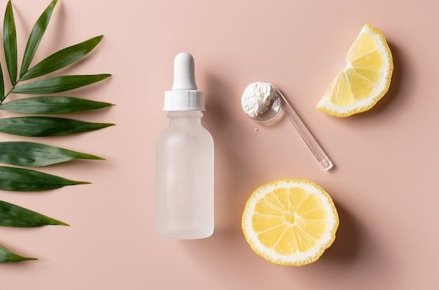 Produto de beleza orgânico natural com vitamina c e rodelas de limão fresco conceito de beleza para a pele