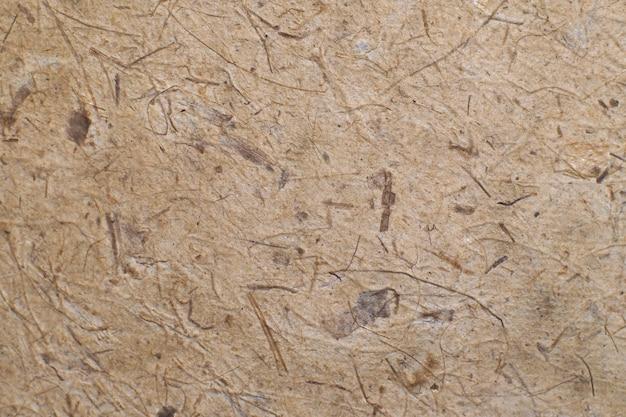 Produto de papel artesanal marrom japonês com textura abstrata com árvore de planta natural ou material de folha