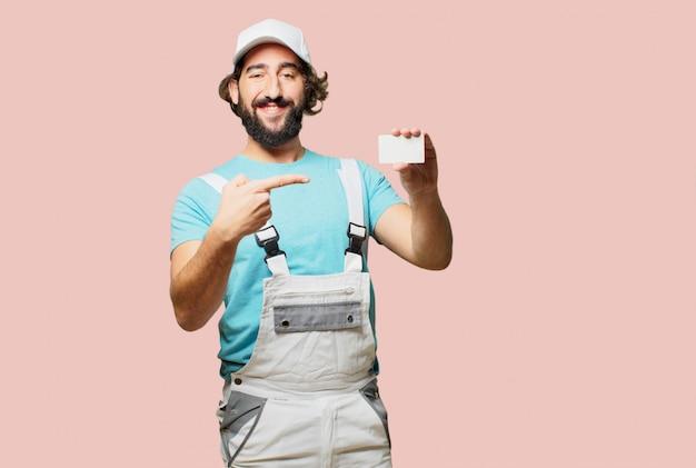 Profesional pintor segurando um cartão de visita