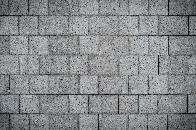 Projeto de textura de piso pavimentado com pedras de tijolo cinza