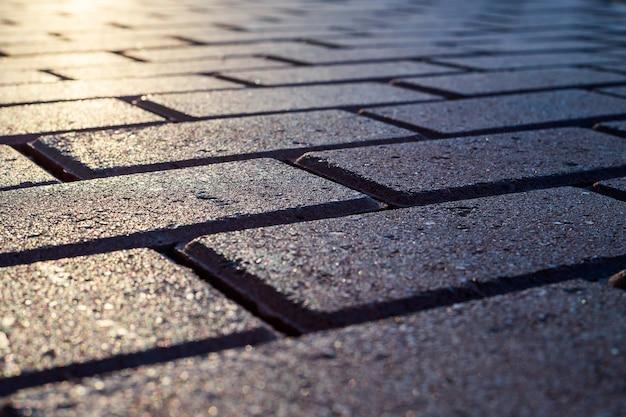 Projeto de tijolo cinza na estrada para pedestres calçadas estradas pavimentadoras