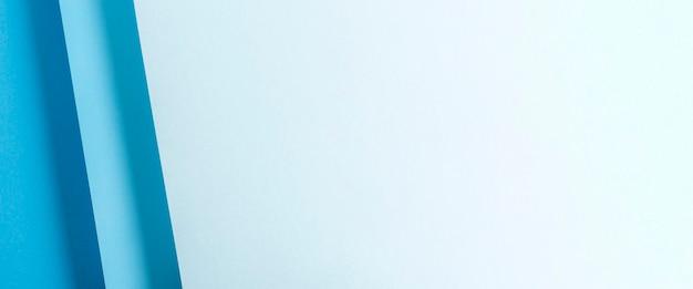 Projeto material de papel dobrado azul colorido. vista superior, configuração plana. bandeira.
