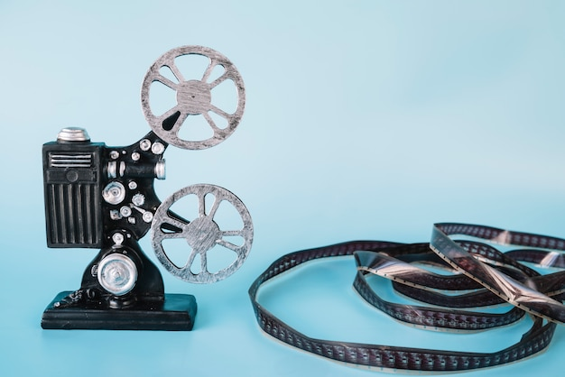 Projetor de filme com bobina de cinema
