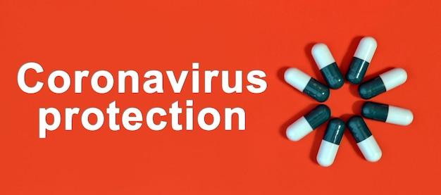 Proteção contra coronavírus - texto branco em um fundo vermelho com cápsulas de comprimidos
