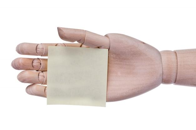 Prótese de mão de madeira mantém o quadro de etiqueta para uma inscrição.
