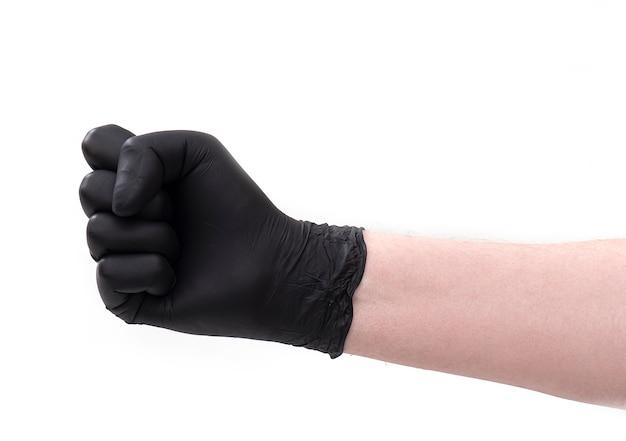 Punho à mão em luvas de látex pretas isoladas.
