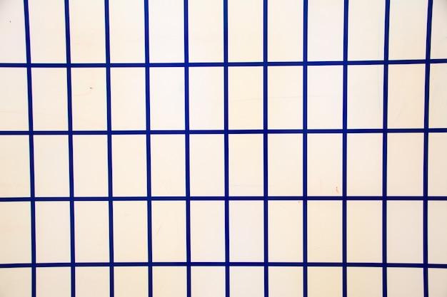 Quadrados azuis. padrão colorido sem emenda. plano de fundo bonito. papel de parede geométrico abstrato da superfície. impressão para poligrafia, pôsteres, camisetas e têxteis. textura geométrica. doodle para design.