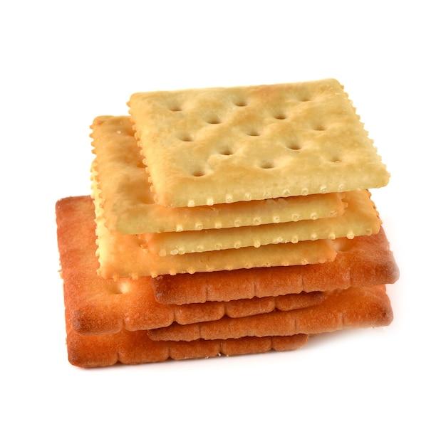 Quadrados sobrepostos de biscoito em branco.