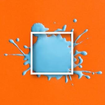 Quadro abstrato com salpicos azuis em laranja