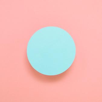 Quadro circular azul em branco sobre fundo colorido