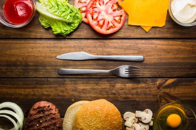 Quadro com ingredientes de hambúrguer prontos para comer